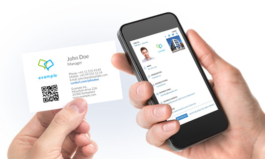 Man holding a phone and a business card